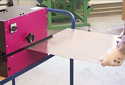 Deburring machine can be used on side for large, thin sheets
