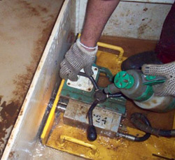 AIRBOR™ Mag Drill cutting holes into ballast