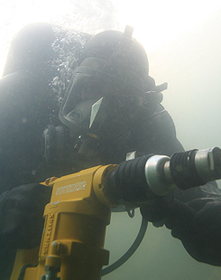 Diver using hydraulic rotary hammer drill