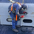 Using needle scaler to restore USS Pampanito