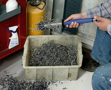 Power Worker (POW 100) holds shavings