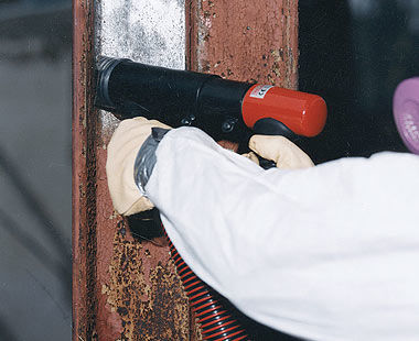 Heavy-Duty Inline Needle Scalers removing paint from I-Beam