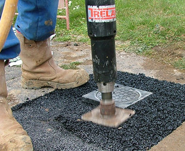 Pole tamper application-asphalt