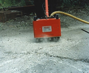 11-head air-powered concrete floor scabbler application