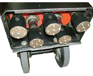Multi-headed concrete floor scabbler for demolition showing 5 bush heads