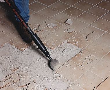 Lifting tile with long-reach scraper