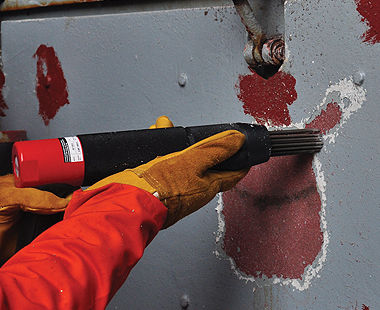 Needle Scaler removing paint from ship