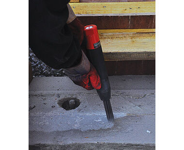 Needle scaler removing concrete