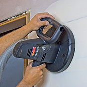 Hand-held drywall sander