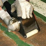 Hand-held concrete scarifier rotopeen