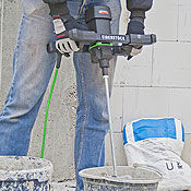 Hand-held mixing drill for concrete and masonry