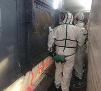 Needle scaler asbestos & lead coating removal on metal