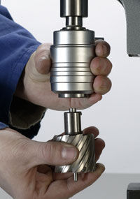 Keyless, quick-change system for annular cutters saves times and money. Just twist and lock.