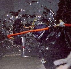 Diver Secures Steel Plates