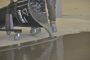 Pelican Transport Cart Pouring Self-Leveling Compound Onto Floor